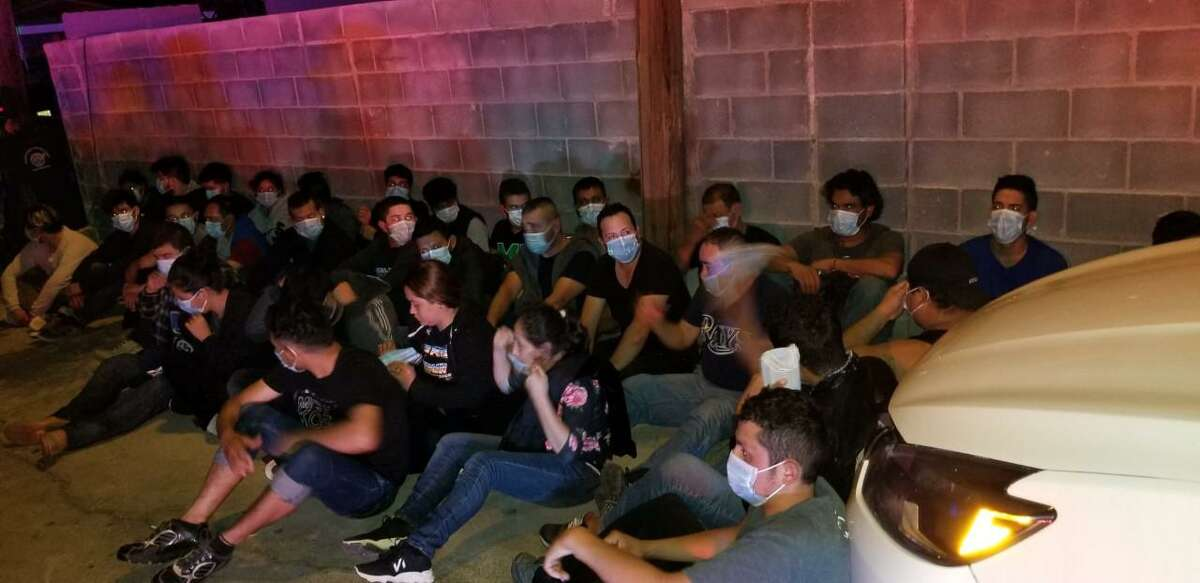 U.S. Border Patrol agents said they found these 32 migrants inside an apartment in the 400 block of West Locus Street.