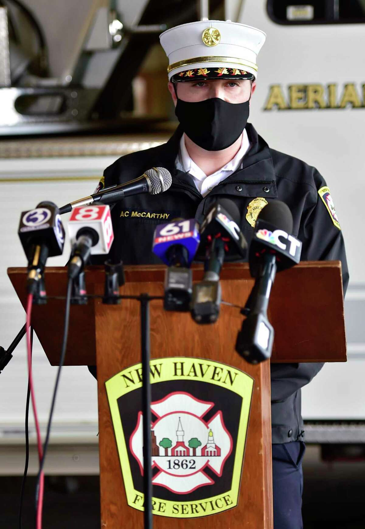 Justin McCarthy, New Haven assistant fire chief for operations, shares an update during a press conference at New Haven fire headquarters on the investigation into a Wednesday fire that left one firefighter dead and another in critical condition.