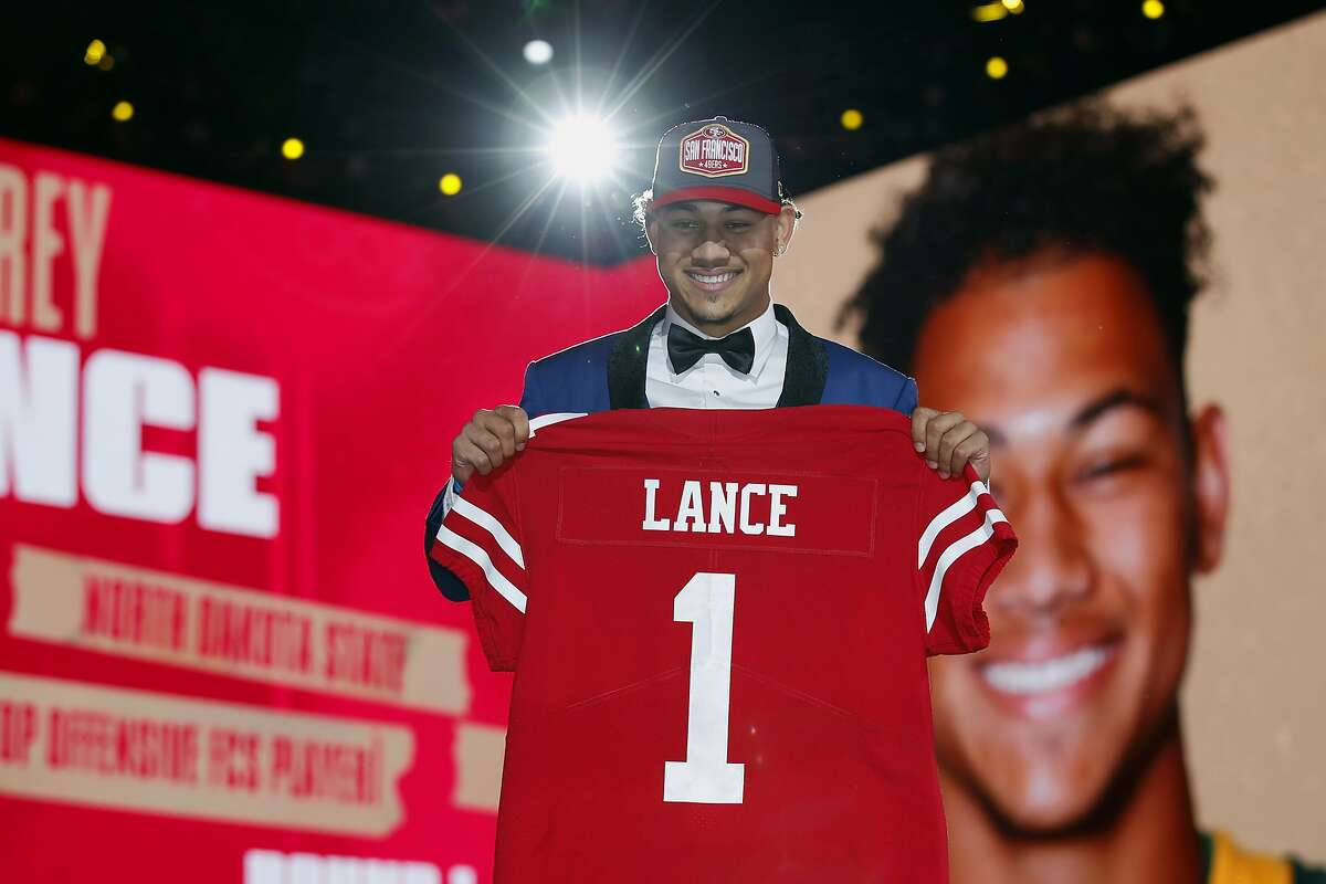 Quarterback Trey Lance holds an NFL jersey after being chosen by the 49ers in the NFL draft last month.