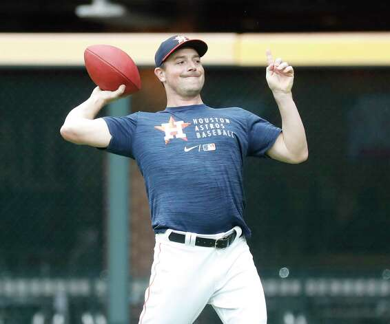 Houston Astros pitcher Joe Smith tosses a football around during batting practice before the start of an MLB baseball game at Minute Maid Park, Thursday, May 13, 2021, in Houston. Photo: Karen Warren, Staff Photographer / @2021 Houston Chronicle