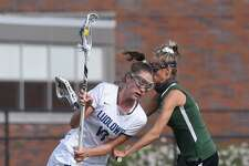 Ludlowe's Kaleigh Sommers (18) drives against Guilford's Taylor Farace during a game in April.