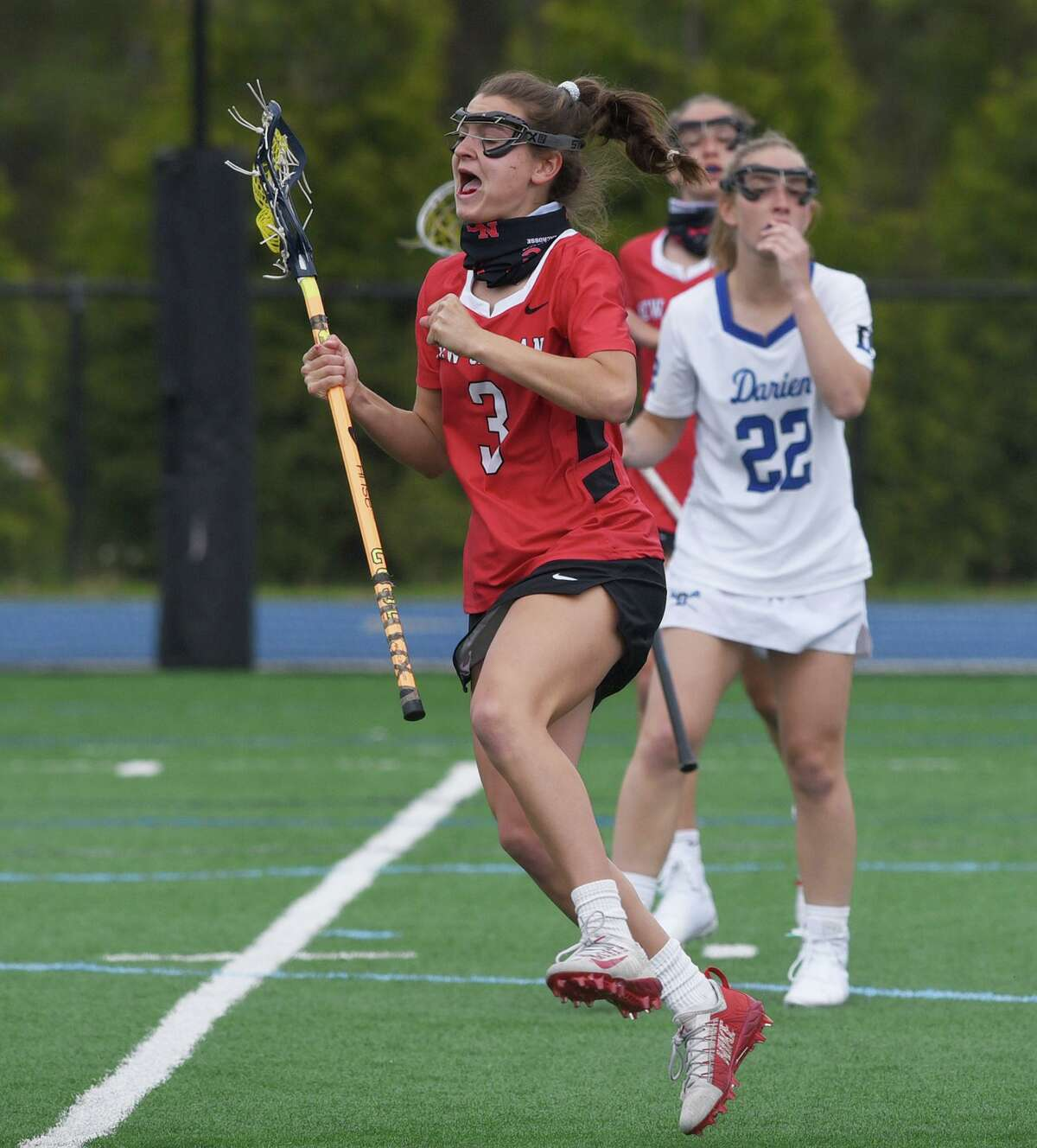 New Canaan's Dillyn Patten (3) celebrates a goal during the Rams' game against Darien on May 3.