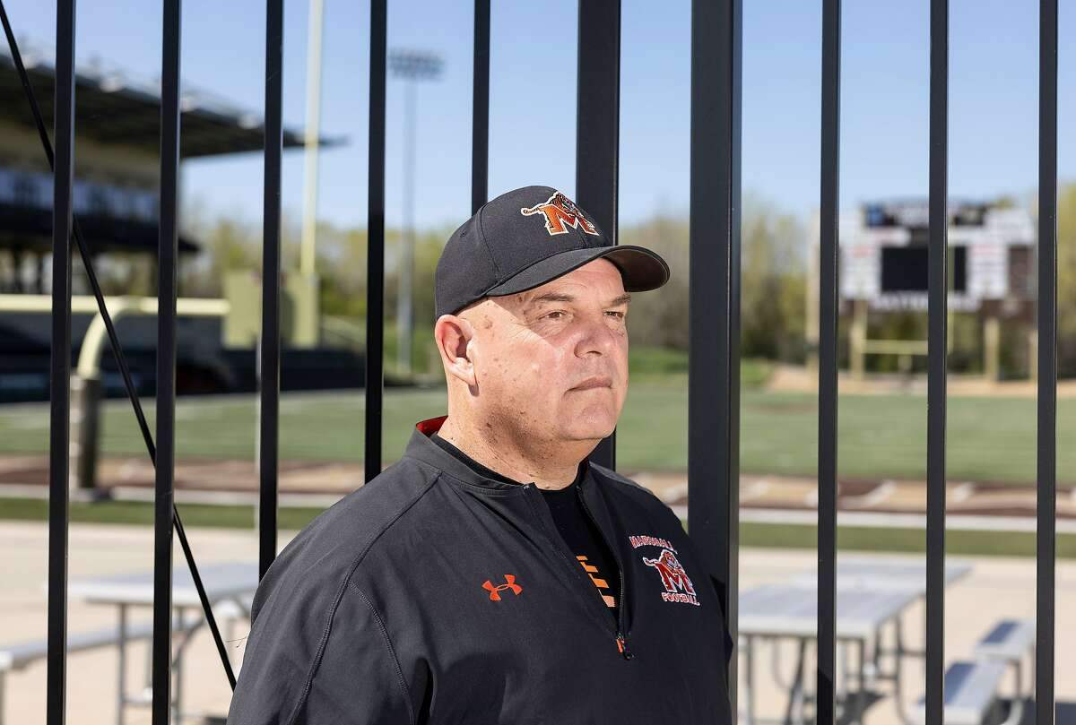 A portrait of Terry Bahlmann, head football coach at Marshall High School, outside of the game field in Marshall, Minn., on Tuesday, May 11, 2021.