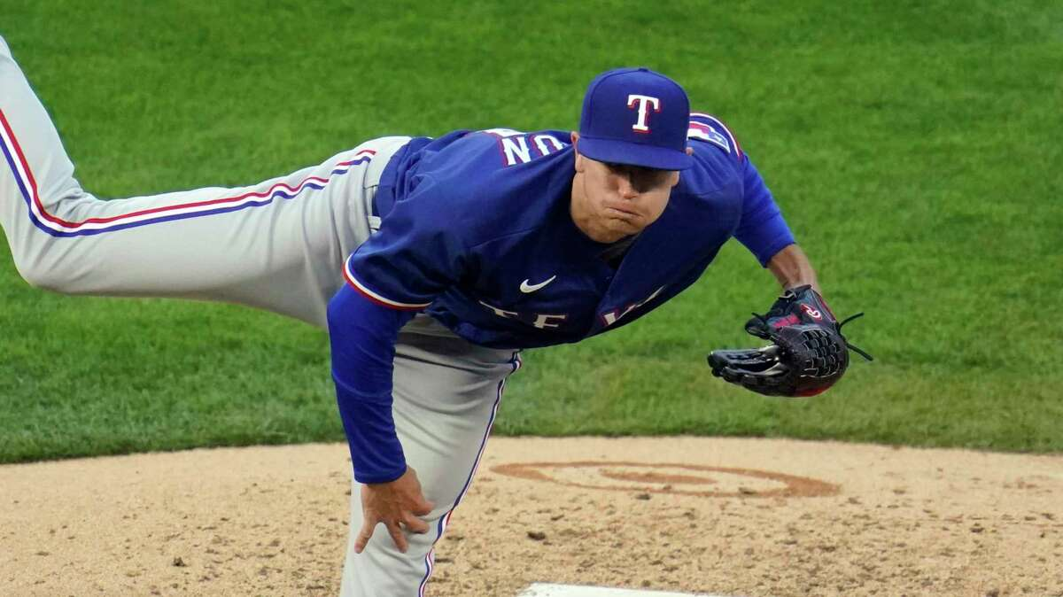 Texas Rangers' pitcher Kyle Gibson throws during a baseball game against the Minnesota Twins, Tuesday, May 4, 2021, in Minneapolis. (AP Photo/Jim Mone)