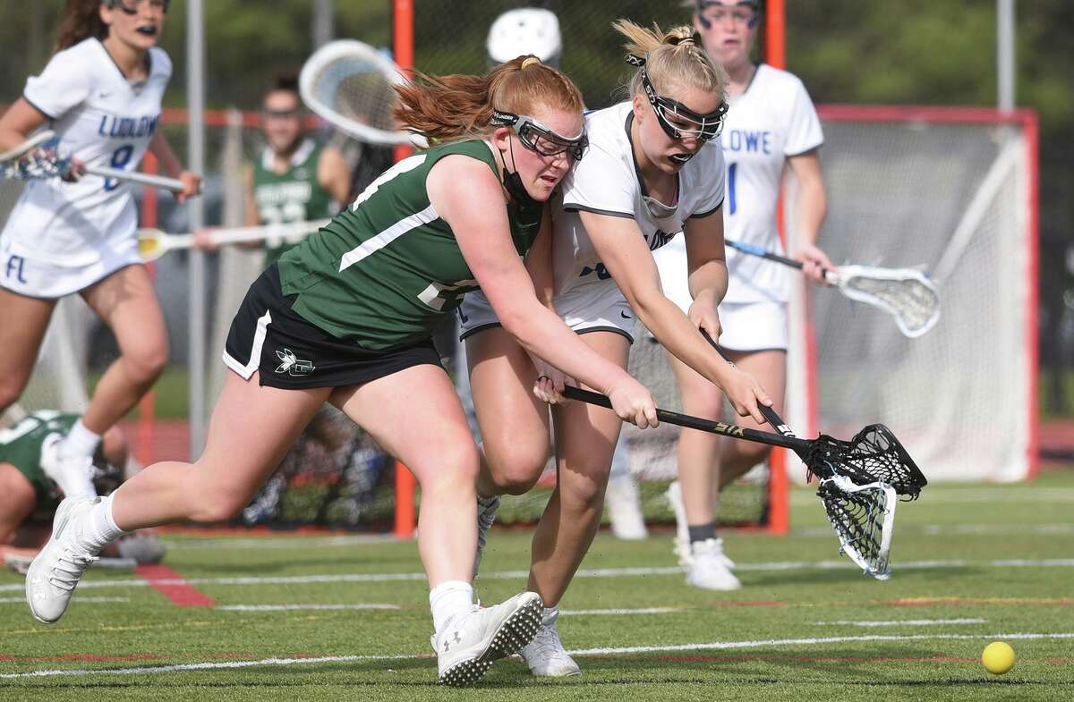 Guilford's Sydney Cunningham (24) and Ludlowe's Claire Davenport (10) battle for a ground ball at Taft Field in Fairfield in April.