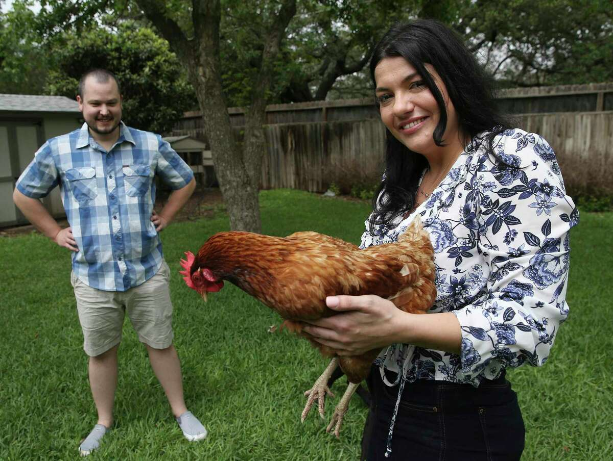 Personal chef Elena D'Agostino poses with one of her three hens. D'Agostino and her boyfriend Matthew Burns raised the hens over the past year and they all have done well including weathering the February winter storm. D'Agostino specializes in making pasta and the eggs laid by the hens provided a bountiful resource for her cooking.