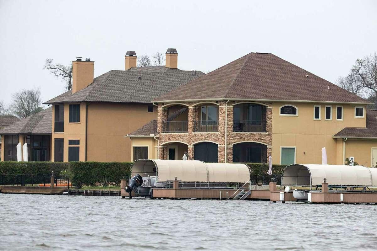 The residence reportedly owned by Lt. Gov. Dan Patrick, on Benthaven Isle on Lake Conroe, right, is shown on Tuesday, Feb. 5, 2019, in Conroe.
