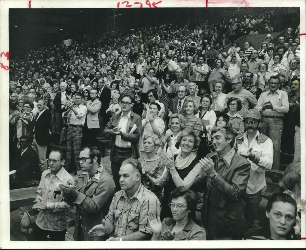 """Part of crowd of 3,000 disgruntled northwest Houston taxpayers in 1978 applauds call for moratorium on city property tax revaluations until a """"more equal and uniform"""" assessing plan is devised."""