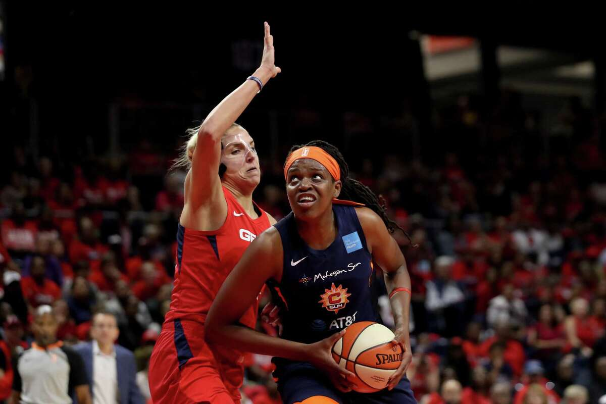 The Sun's Jonquel Jones, right, drives to the basket against the Mystics' Elena Delle Donne during Game 5 of the 2019 WNBA Finals in Washington.