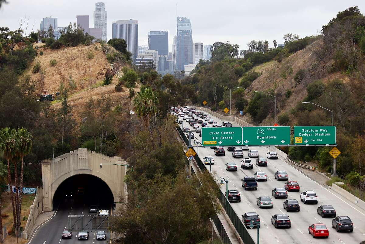 LOS ANGELES, CALIFORNIA - APRIL 22: Cars make their way toward downtown L.A. during the morning commute on April 22, 2021 in Los Angeles, California. President Joe Biden pledged to cut U.S. greenhouse gas emissions in half by 2030 at the Earth Day climate summit. (Photo by Mario Tama/Getty Images)