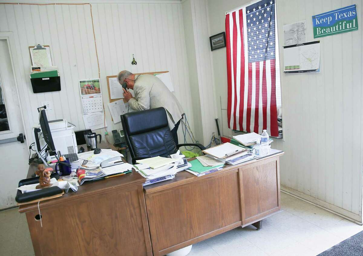 Walker County Commissioner Jimmy Henry takes a call in his office in New Waverly on Wednesday, May 5, 2021. Henry did a grassroots survey where he found nearly one in four Walker County households said they do not subscribe to home internet service.