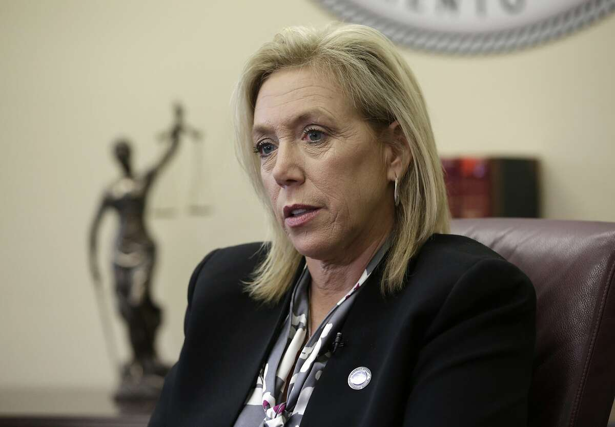 FILE - In this April 27, 2018, file photo, Sacramento County District Attorney Anne Marie Schubert pauses during an interview in her office in Sacramento, Calif. AP Photo/Rich Pedroncelli, File