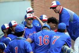 Jefferson baseball head coach Xavier Garcia huddles with his team after losing 5-0 to Dripping Springs in the District 5A second round at North East Sports Park, Thursday, May 13, 2021.