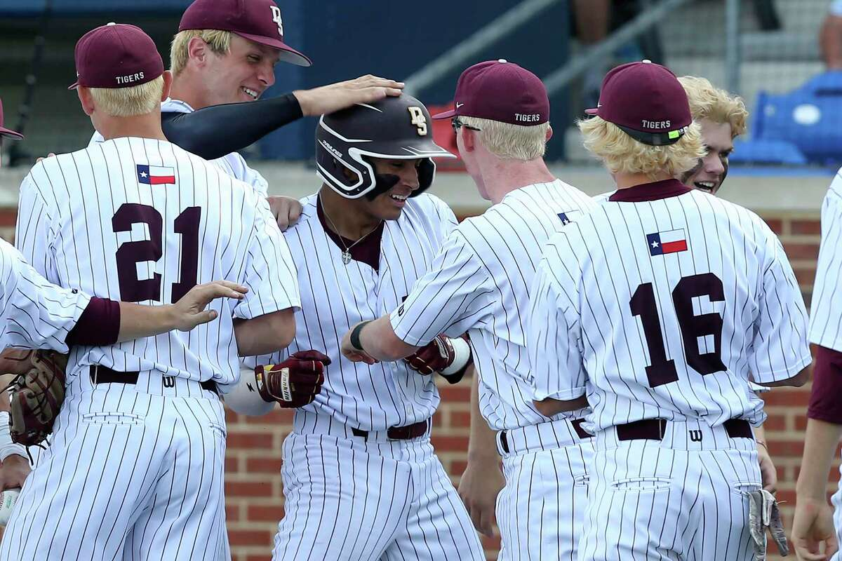 Dripping Spring?•s players surround Nico Ruedas after his three-run hit at the bottom of the fifth against Jefferson at North East Sports Park, Thursday, May 13, 2021. Dripping Springs went on to win the District 5A second round game, 5-0.