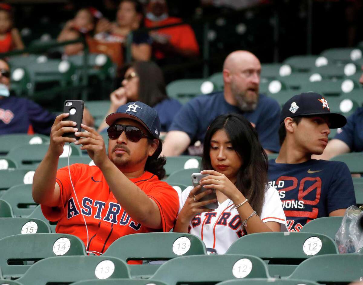 Baseball fans in the stands before the start of the first inning of an MLB baseball game at Minute Maid Park, Thursday, May 13, 2021, in Houston.