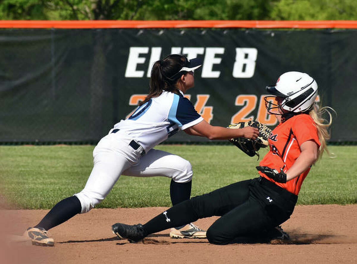 Edwardsville's Tayler Hope slides safely into second base with a double in the first inning against Belleville East on Thursday inside the District 7 Sports Complex.