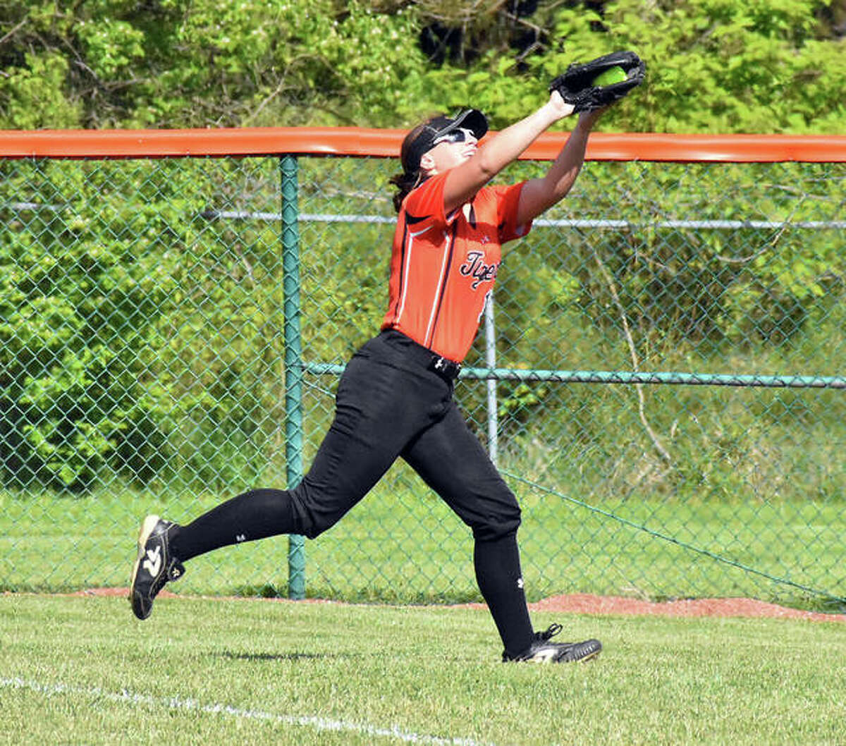 Edwardsville's Sydney Lawrence makes a running catch in foul territory in the first inning against Belleville East on Thursday inside the District 7 Sports Complex.