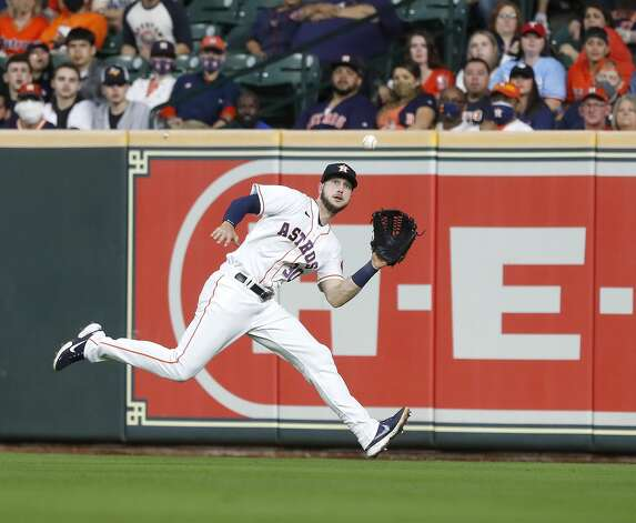 Houston Astros right fielder Kyle Tucker (30) catches Texas Rangers Nate Lowe's line out during the third inning of an MLB baseball game at Minute Maid Park, Thursday, May 13, 2021, in Houston. Photo: Karen Warren/Staff Photographer / @2021 Houston Chronicle