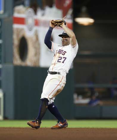 Houston Astros second baseman Jose Altuve (27) catches Texas Rangers Charlie Culberson's pop out during the fourth inning of an MLB baseball game at Minute Maid Park, Thursday, May 13, 2021, in Houston. Photo: Karen Warren/Staff Photographer / @2021 Houston Chronicle