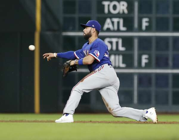 Texas Rangers shortstop Isiah Kiner-Falefa (9) makes the throw to third base to get Houston Astros Myles Straw out during the fourth inning of an MLB baseball game at Minute Maid Park, Thursday, May 13, 2021, in Houston. Photo: Karen Warren/Staff Photographer / @2021 Houston Chronicle