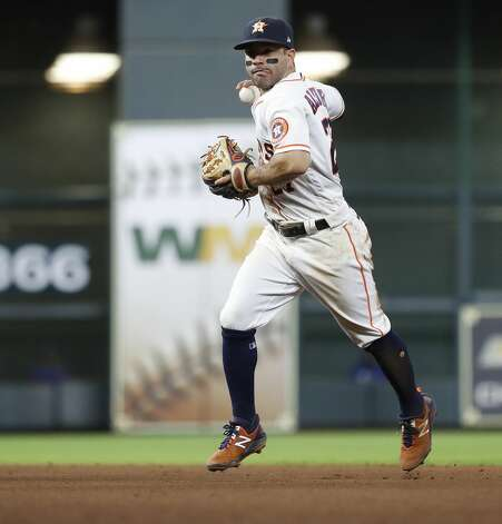 Houston Astros second baseman Jose Altuve (27) makes the throw to first base as Texas Rangers Willie Calhoun ground out during the fifth inning of an MLB baseball game at Minute Maid Park, Thursday, May 13, 2021, in Houston. Photo: Karen Warren/Staff Photographer / @2021 Houston Chronicle