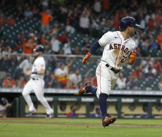 Houston Astros Jose Altuve (27) runs to second base after hitting an RBI double during the second inning of an MLB baseball game at Minute Maid Park, Thursday, May 13, 2021, in Houston. Photo: Karen Warren/Staff Photographer / @2021 Houston Chronicle