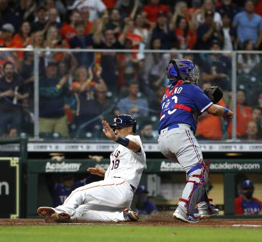 Houston Astros Jason Castro (18) slides home to score a run on Jose Altuve's RBI double during the second inning of an MLB baseball game at Minute Maid Park, Thursday, May 13, 2021, in Houston. Photo: Karen Warren/Staff Photographer / @2021 Houston Chronicle