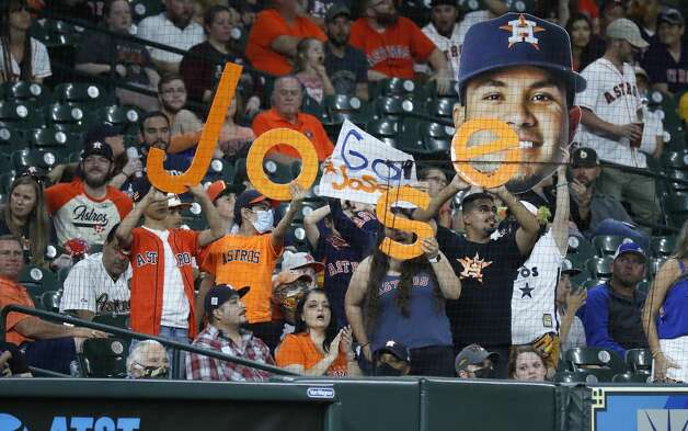 Houston Astros fans cheer for second baseman Jose Altuve during the fourth inning of an MLB baseball game at Minute Maid Park, Thursday, May 13, 2021, in Houston. Photo: Karen Warren/Staff Photographer / @2021 Houston Chronicle