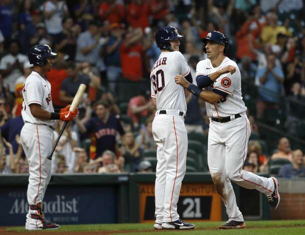 Houston Astros Jason Castro (18) celebrates with Kyle Tucker after he scored a run on Jose Altuve's RBI double during the second inning of an MLB baseball game at Minute Maid Park, Thursday, May 13, 2021, in Houston. Photo: Karen Warren/Staff Photographer / @2021 Houston Chronicle