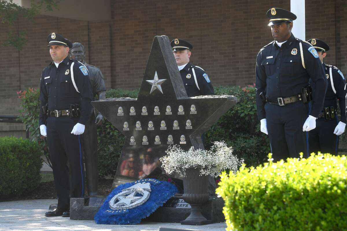 Honor Guard members stand by after a wreath is placed and then flowers in remembrance of the 18 officers who have fallen in the line of duty, the most recent of which was Sheena Yarbrough-Powell, who was killed in August, 2020. Photo made Thursday, May 13, 2021 Kim Brent/The Enterprise