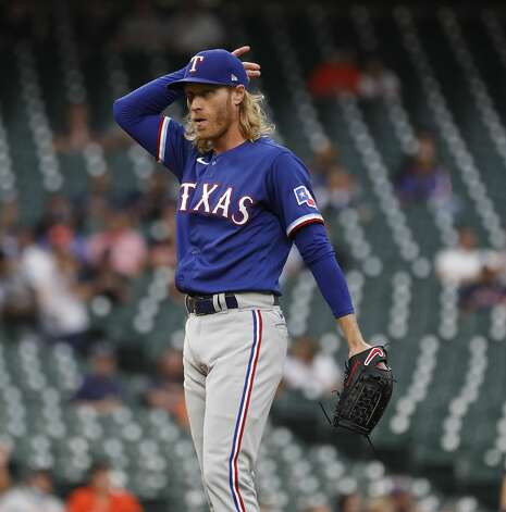 Texas Rangers starting pitcher Mike Foltynewicz (20) between pitches during the first inning of an MLB baseball game at Minute Maid Park, Thursday, May 13, 2021, in Houston. Photo: Karen Warren/Staff Photographer / @2021 Houston Chronicle