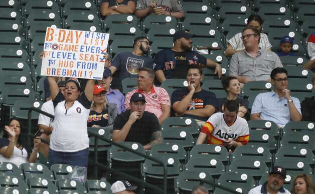 A fan with a sign for Jose Altuve during the first inning of an MLB baseball game at Minute Maid Park, Thursday, May 13, 2021, in Houston. Photo: Karen Warren/Staff Photographer / @2021 Houston Chronicle
