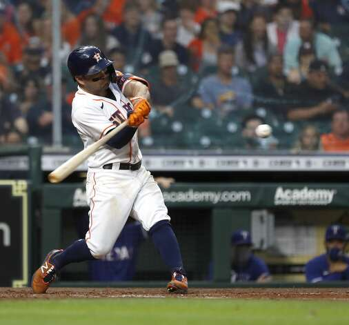Houston Astros Jose Altuve (27) hits an RBI double during the second inning of an MLB baseball game at Minute Maid Park, Thursday, May 13, 2021, in Houston. Photo: Karen Warren/Staff Photographer / @2021 Houston Chronicle