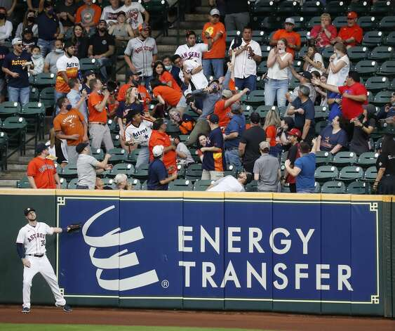 Fans reach for Texas Rangers Willie Calhoun's home run ball off of Houston Astros starting pitcher Cristian Javier's first pitch during the first inning of an MLB baseball game at Minute Maid Park, Thursday, May 13, 2021, in Houston. Photo: Karen Warren/Staff Photographer / @2021 Houston Chronicle