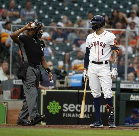 Houston Astros shortstop Carlos Correa (1) argues with home plate umpire Ramon De Jesus after being called out on strikes during the first inning of an MLB baseball game at Minute Maid Park, Thursday, May 13, 2021, in Houston. Photo: Karen Warren/Staff Photographer / @2021 Houston Chronicle