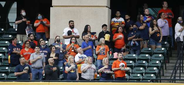Fans in the Crawford Boxes during the National Anthem before the start of the first inning of an MLB baseball game at Minute Maid Park, Thursday, May 13, 2021, in Houston. Photo: Karen Warren/Staff Photographer / @2021 Houston Chronicle