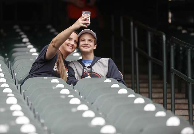 Baseball fans in the stands before the start of the first inning of an MLB baseball game at Minute Maid Park, Thursday, May 13, 2021, in Houston. Photo: Karen Warren/Staff Photographer / @2021 Houston Chronicle