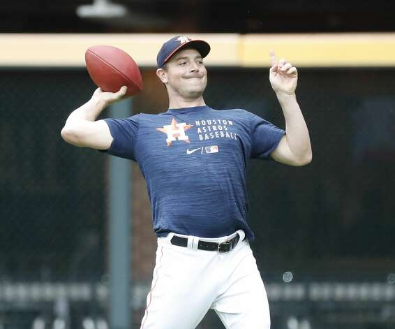 Houston Astros pitcher Joe Smith tosses a football around during batting practice before the start of an MLB baseball game at Minute Maid Park, Thursday, May 13, 2021, in Houston. Photo: Karen Warren/Staff Photographer / @2021 Houston Chronicle