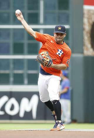 Houston Astros Jose Altuve throws during infield practice before the start of an MLB baseball game at Minute Maid Park, Thursday, May 13, 2021, in Houston. Photo: Karen Warren/Staff Photographer / @2021 Houston Chronicle