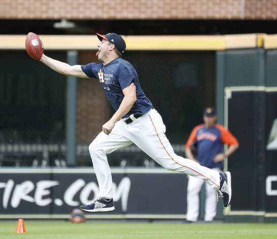 Houston Astros pitcher Joe Smith catches a football during batting practice before the start of an MLB baseball game at Minute Maid Park, Thursday, May 13, 2021, in Houston. Photo: Karen Warren/Staff Photographer / @2021 Houston Chronicle