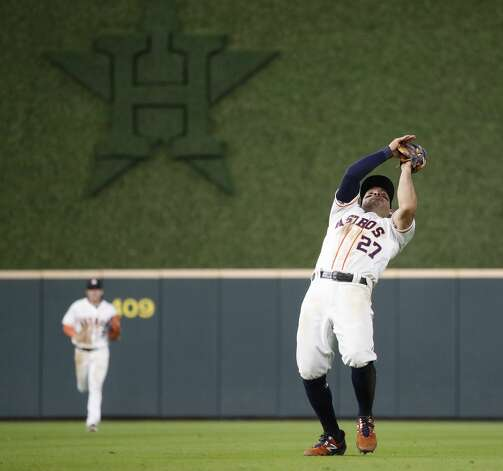 Houston Astros second baseman Jose Altuve (27) catches Texas Rangers Nick Solak's pop out during the fifth inning of an MLB baseball game at Minute Maid Park, Thursday, May 13, 2021, in Houston. Photo: Karen Warren/Staff Photographer / @2021 Houston Chronicle