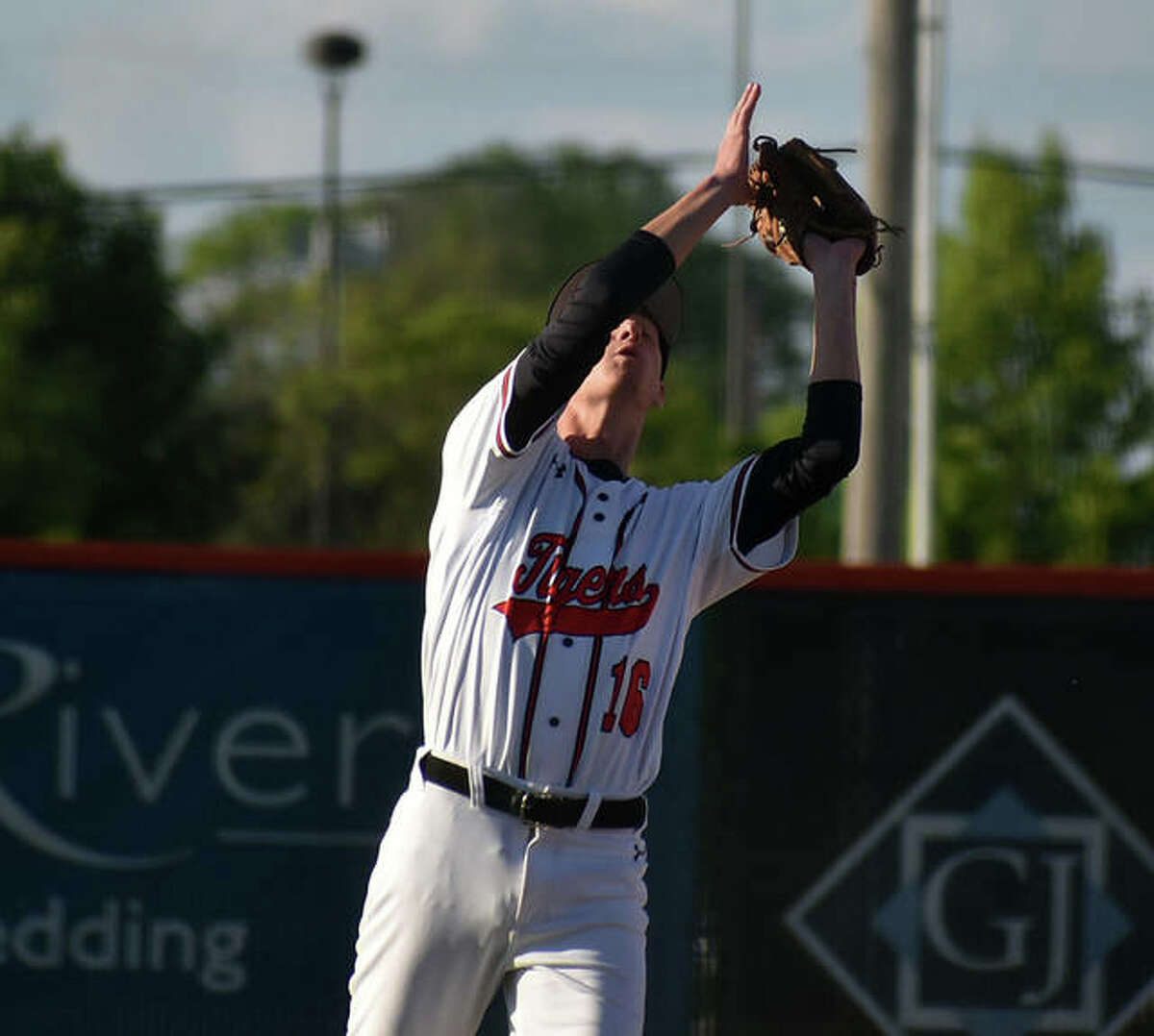 Edwardsville third baseman Trent Schroeder catches a fly ball in the sixth inning against Alton.