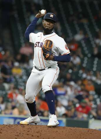 Houston Astros starting pitcher Cristian Javier (53) tries to pick off Texas Rangers Isiah Kiner-Falefa on first base during the seventh inning of an MLB baseball game at Minute Maid Park, Thursday, May 13, 2021, in Houston. Photo: Karen Warren/Staff Photographer / @2021 Houston Chronicle