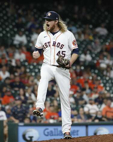 Houston Astros relief pitcher Ryne Stanek (45) reacts after Texas Rangers Adolis Garcia struck out to end the top of the eighth inning of an MLB baseball game at Minute Maid Park, Thursday, May 13, 2021, in Houston. Photo: Karen Warren/Staff Photographer / @2021 Houston Chronicle
