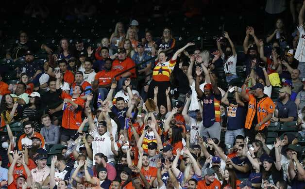 Fans do the wave during the seventh inning of an MLB baseball game at Minute Maid Park, Thursday, May 13, 2021, in Houston. Photo: Karen Warren/Staff Photographer / @2021 Houston Chronicle