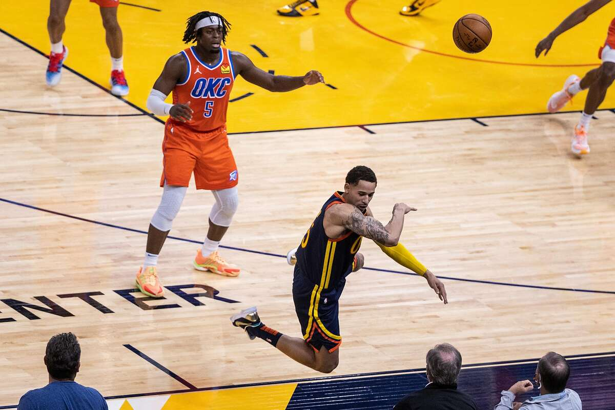 Golden State Warriors forward Juan Toscano-Anderson (95) leaps to make a save during the third quarter of his NBA basketball game against the Oklahoma City Thunder in San Francisco, Calif. on Thursday, May 6, 2021.