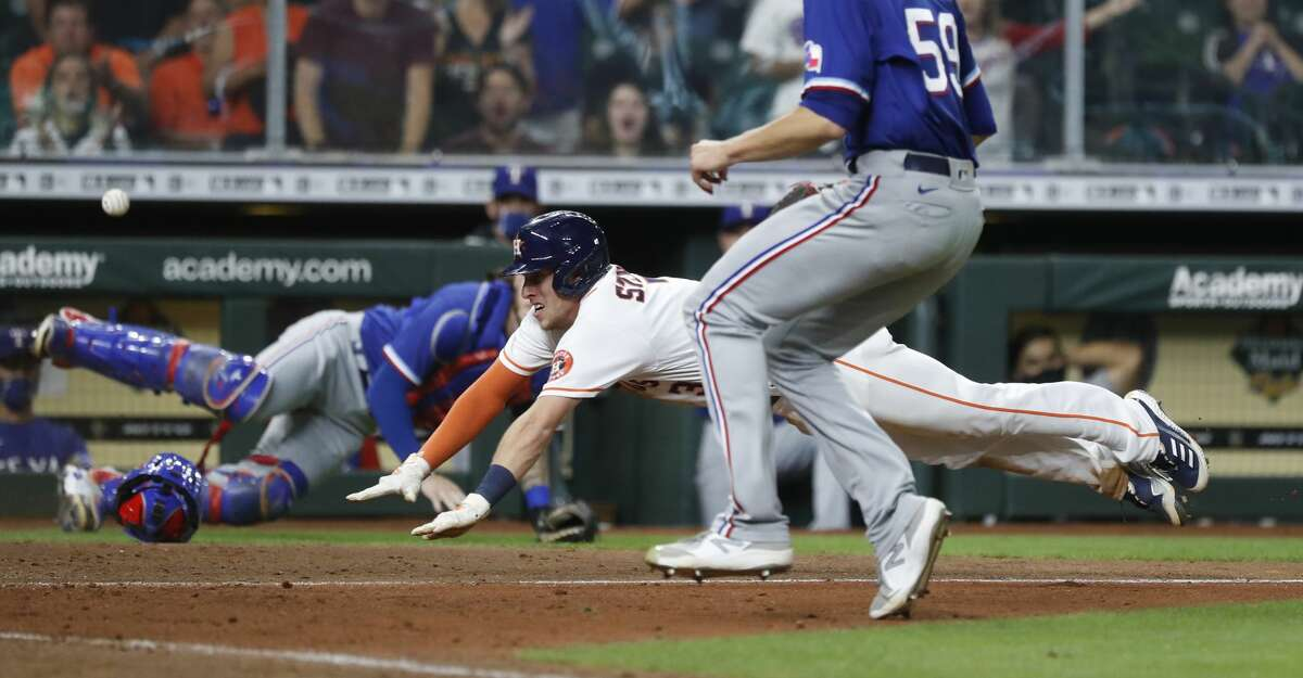 Houston Astros Myles Straw (3) scores the winning run on a wild pitch by Texas Rangers pitcher Brett Martin during the eleventh inning of an MLB baseball game at Minute Maid Park, Thursday, May 13, 2021, in Houston. Astros win 4-3.