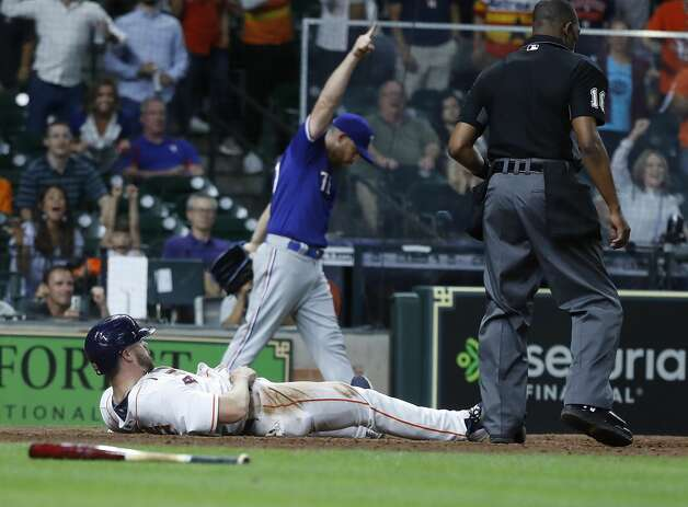Houston Astros Chas McCormick (20) tries to dive home but was tagged out at the plate by Texas Rangers catcher Jonah Heim during the tenth inning of an MLB baseball game at Minute Maid Park, Thursday, May 13, 2021, in Houston. Photo: Karen Warren/Staff Photographer / @2021 Houston Chronicle