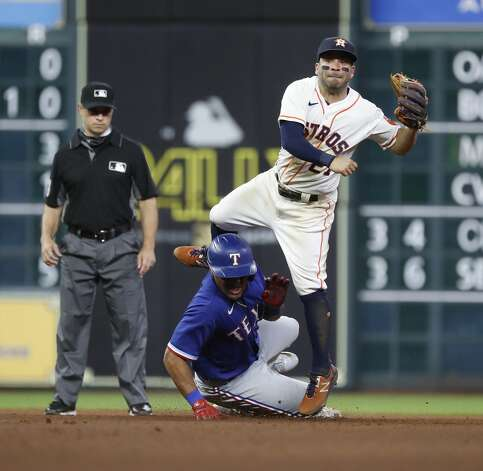 Houston Astros second baseman Jose Altuve (27) makes the throw to first after tagging Texas Rangers Andy Ibanez as Khris Davis ground into a double play during the tenth inning of an MLB baseball game at Minute Maid Park, Thursday, May 13, 2021, in Houston. Photo: Karen Warren/Staff Photographer / @2021 Houston Chronicle