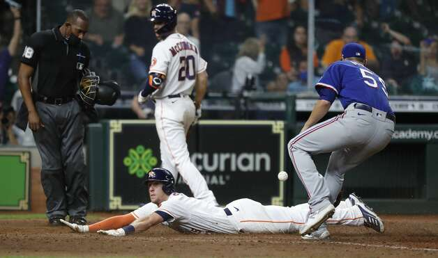 Houston Astros Myles Straw (3) scores the winning run on a wild pitch by Texas Rangers pitcher Brett Martin during the eleventh inning of an MLB baseball game at Minute Maid Park, Thursday, May 13, 2021, in Houston. Astros win 4-3. Photo: Karen Warren/Staff Photographer / @2021 Houston Chronicle